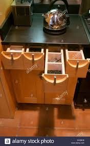 modern kitchen unit modern kitchen unit with chrome kettle on black granite worktop