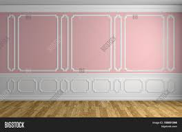 pink wall with white moldings and decorations on wall in classic