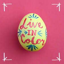 add interest to your easter eggs with food color and a paint brush