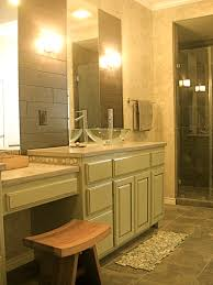 asian inspired bathroom home design ideas wood wall glazed cabinets asian inspired bathroom vessel sink pebble bath mat