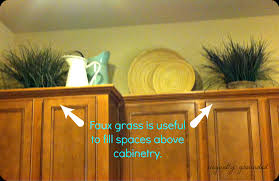 Decor For Top Of Kitchen Cabinets by Decorating Above Kitchen Cabinets For Christmas Home And Interior
