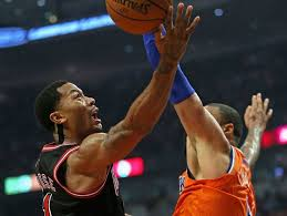 the nba bans and then un bans derrick rose from wearing