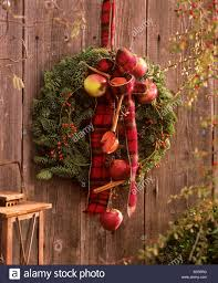 door wreath with noble fir hips and ornamental apples stock