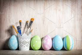 pastel easter eggs pastel easter eggs and brushes in a rustic cup photos