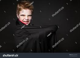 cute boy dressed vampire halloween party stock photo 223773919