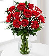 one dozen roses one dozen vased roses the flowerloft