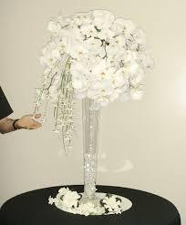 orchid centerpiece and stephanotis centerpiece