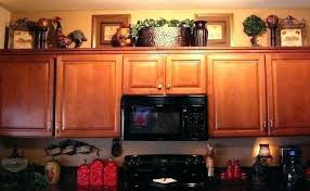 ideas for decorating above kitchen cabinets above kitchen cabinet decorating greenery above kitchen cabinets