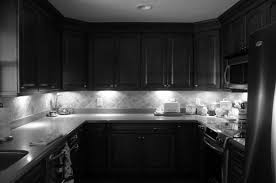 awesome black kitchen cabinets with white marble countertops plus