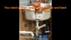 how to use drain snake clogged kitchen sink unclog bathroom