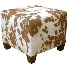 Handmade Ottoman This Handmade Ottoman Features Faux Cowhide Upholstery And A Cube