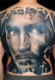 cool portrait of jesus in a crown of thorns tattoo on whole back