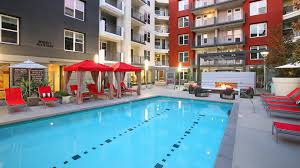 home plans with a courtyard and swimming pool in the center the alton apartments irvine business corridor 2501 alton