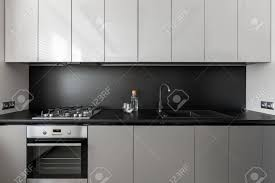 grey kitchen cupboards with black worktop modern kitchen unit in black and white black worktop and backsplash