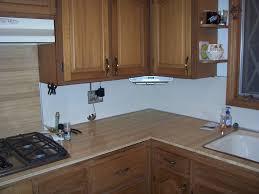 glass countertops under cabinet kitchen tv lighting flooring sink