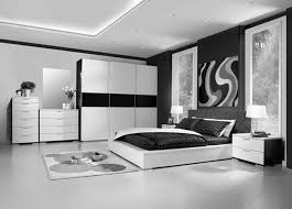 very sleek black and white bedroom with glossy floor and closet