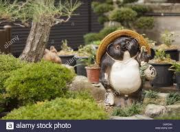 japanese garden statue of tanuki the raccoon animal kyoto
