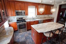 maple kitchen cabinets with white granite countertops saturnia granite archives guys remodeling