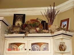 kitchen decorating ideas above cabinets decorate above kitchen cabinets click here for amazing ideas to