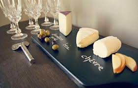 chalkboard cheese plate he pours black paint on a brand new plate after it dries such a