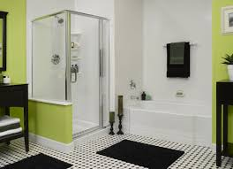 bathroom walk in shower ideas with black bath mat and glass door