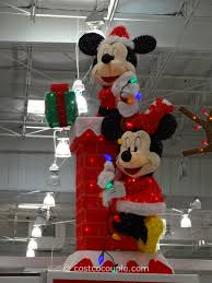 Minnie Mouse Christmas Decorations Mickey And Minnie Decorating The Chimney