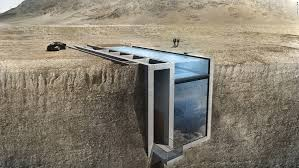 inside a a house is being built inside a cliff thanks to the
