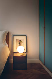 ic light t1 low brass designed by michael anastassiades for flos