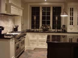 kitchen backsplash with black granite countertops and white