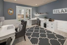 traditional home office with carpet u0026 built in bookshelf in