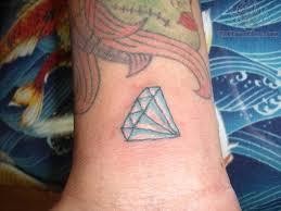 small blue diamond tattoo