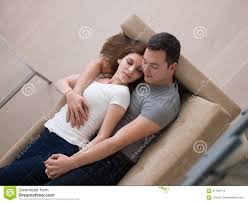 where to buy free hug sofa young handsome couple hugging on the sofa stock photo image of