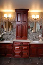 double sink vanity with middle tower i like the middle cabinetry makes it so you can hide way things