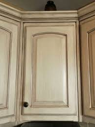 learn to paint a cream cabinet with glaze kitchen cabinet