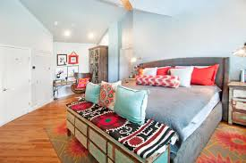colorful master bedroom aqua and coral accents make a bold colorful statement in this