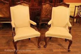 queen anne dining chairs arm upholstered with neutral linen fabric