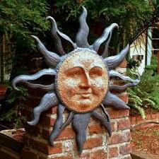 large rising sun face celestial garden wall plaque decor indoor