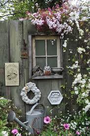 astréor prenons le temps fence art window and flower boxes