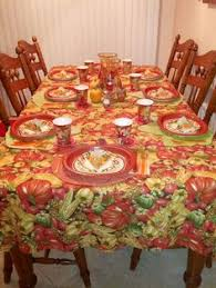 thanksgiving table set up with matching plates napkins other