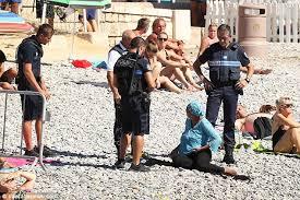 get u0027em off armed police order muslim woman to remove her burkini