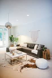 Living Room With Area Rug by Best 25 Cowhide Rug Decor Ideas On Pinterest Cowhide Rugs
