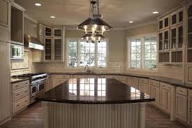 granite countertops for ivory cabinets tan kitchen cabinets with black granite countertops transitional