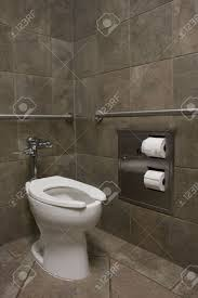 White Walls Clean by Clean White Toilet In A Public Restroom With Dark Stone Walls