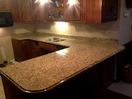 what color countertops go with brown cabinets classic marble