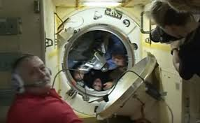 do iss astronauts put on their suits prior to entering the soyuz