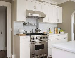 carrara marble subway tile kitchen backsplash white viking range and transitional kitchen