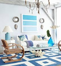 Beach Living Room Ideas by Rustic Gold Chandelier With Blue Geometric Carpet And Plexiglass