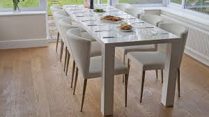 the modern white hi gloss extending dining set seats up to 10