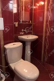 luxury bathroom design in burgundy color with golden ornaments