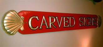 carved signs with 23k gold letters